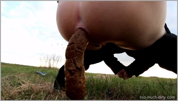 Girl_Dumps_a_Monster_Shit_Outdoor_in_the_Fields